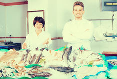 Ordinary fish store with two smiling sellers Stock Photography