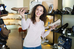Ordinary girl chooses summer shoes Stock Images