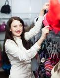 Ordinary girl choosing bra Stock Images