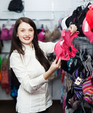 Ordinary girl choosing underwear at store Royalty Free Stock Photography