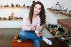 Ordinary girl select summer shoes Stock Photography