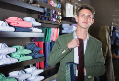 Ordinary guy choosing new tie Royalty Free Stock Photos