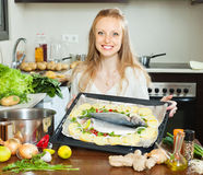 Ordinary housewife cooking fish  in sheet pan Stock Images