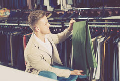 Ordinary man choosing new trousers Stock Image