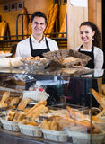 Ordinary man and girl selling pastry and loaves Stock Image