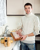 Ordinary Man Holding Raw Meat In Home Kitchen Royalty Free Stock Images