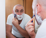 Ordinary Man shaving Stock Photos