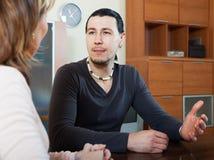 Ordinary man and woman talking Stock Photography