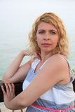 Ordinary middle-aged woman against ocean background Royalty Free Stock Photos