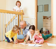 Ordinary multigeneration family. With  children  on floor at home Stock Photos