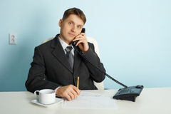 Ordinary official in office - talking on phone Royalty Free Stock Images