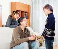 Ordinary parents berating teenager son Stock Image