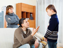 Ordinary parents berating teenager son Royalty Free Stock Photography