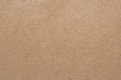 New yellow-beige plaster texture on a house royalty free stock photography