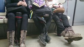 Ordinary people in subway, commuters sitting in metro train. Stock footage stock video footage