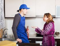 Ordinary plumber working at kitchen Royalty Free Stock Photography