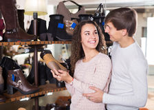 Ordinary positive  couple shopping at shoe store Stock Image