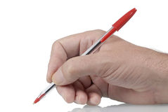 Ordinary red ballpoint pen in male hand Royalty Free Stock Images