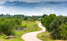 Ordinary rural landscape on a summer cloudy day. Prspective royalty free stock photos