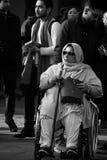 Urban life - Mulslim lady on a wheelchair Stock Photos