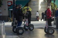 Urban life -People walking on segways Royalty Free Stock Photo