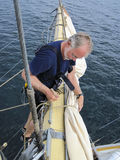 Seaman working aloft on tallship Royalty Free Stock Image