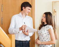 Ordinary social worker questioning woman Royalty Free Stock Images