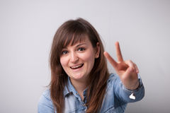 Ordinary successful girl showing off fingers Royalty Free Stock Photo