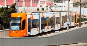 Ordinary tram on street of city. Alicante Stock Photo