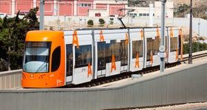 Ordinary tram on street of city. Alicante Stock Photo