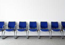 Ordinary waiting room. Blue chairs in ordinary empty waiting room Stock Photo