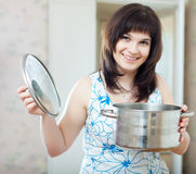 Ordinary woman with cook pan Stock Photos