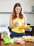 Ordinary woman cooking sandwiches Royalty Free Stock Photography