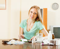 Ordinary woman counting the cost of treatment. At home Royalty Free Stock Photography