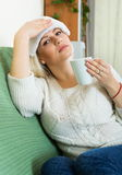Ordinary woman with huge migraine Stock Photo