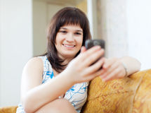 Ordinary woman sends SMS Royalty Free Stock Image