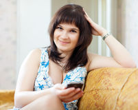Ordinary woman sends SMS by mobile Royalty Free Stock Photography