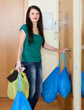 Ordinary woman taking away the garbage Stock Photo