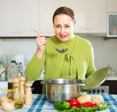Ordinary woman tasting soup Royalty Free Stock Images