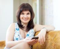 Ordinary woman using device royalty free stock photos
