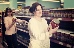 Ordinary women purchasing pickled vegetables Royalty Free Stock Photos
