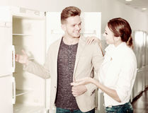 Ordinary young customers looking at fridges Stock Photography