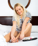Ordinary young woman doing domestic pedicure Royalty Free Stock Images