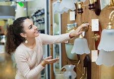 Ordinary young woman doing shopping Royalty Free Stock Photos