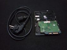 Ordinateur de puissance et de hardisk de câble photographie stock libre de droits