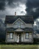 Ordinateur de secours sur le porche dans une tempête Photographie stock libre de droits