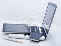 Ordinateur portable, comprimé et téléphone Image stock