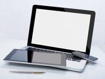 Ordinateur portable, comprimé et téléphone Photos stock