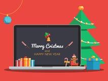 Ordinateur portable et arbre de Noël Photos libres de droits