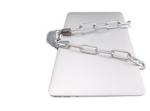 Ordinateur portable et chaînes III images stock